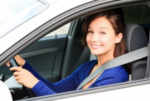 bigstock-happy-female-driver-smiling-to-33937628